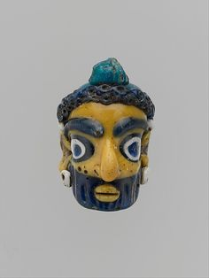 Carthaginian glass head pendant, mid-4th to 3rd century BCE. From the collection of the Metropolitan Museum of Art.