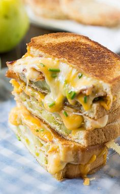 Fried Green Tomato & Bacon Grilled Cheese _ With crispy & slightly tart fried green tomatoes, a mound of gooey cheese, & slices of bacon, this is the ultimate Southern grilled cheese sandwich!