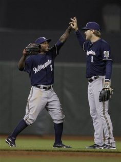 25/162 - Brewers 6, Giants 4 - Brewers center fielder Nyjer Morgan (2) and right fielder Corey Hart (1) celebrater after the final out of the ninth inning - (May 4)