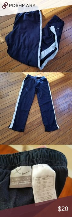 Nike workout pants Navy windbreaker material athletic pants with pockets. Good condition. Nike Pants Track Pants & Joggers