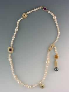 I've added elements to a classic pearl necklace to make it more modern.