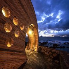 """Congratulations to Cella Bar and architect Fernando Coelho for winning the Archdaily Building of the Year Award! This incredible space is in Pico Island, Azores, Portugal. The bar is modern, organic and inspired by the wine in the region and the sea. It's a """"must visit"""" if you are in Azores!"""