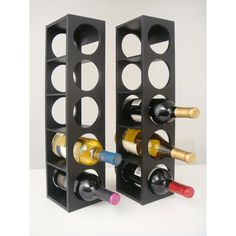 Show off your wine collection with this contemporary black wine rack. The sleek, modern design complements virtually any decor. Each sturdy rack holds five wine bottles and can be mounted on a wall or displayed on a countertop or table.