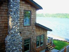 "Whispering Waters Cottage, This is my timberframe cottage I designed and built myself . It is located in Port Orchard Washington and sits on the waterfront on Puget Sound straight across from Seattle.  I used red cedar shakes for the roofing and siding and Eldorado stone for the siding pillars and chimney.  The flagstone is cowboy coffee. The house is featured in ""Timberhomes Illustrated"" magazine in the May issue!!, , Home Exterior Design"