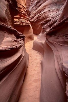 Spooky Gulch, south of Escalante, Utah. Travelers who are claustrophobic may want to avoid hiking Spooky Gulch. Passageways are so narrow in some places, hikers have to squeeze through sideways. It also can be quite dark on the canyon bottom. This canyon walk is 5 km (3.2 miles) roundtrip. Those who don't want to go back the way they came can climb the canyon walls or continue on through Peek-a-boo Gulch, another beautiful slot canyon.
