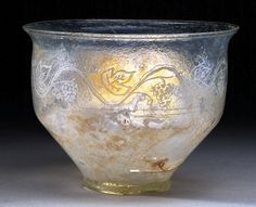 Roman Blown Glass Cup Engraved with Grape Vines (200 - 300).