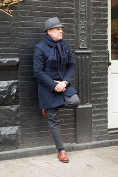 Rock a navy overcoat with dark grey dress pants like a true gent. Mix things up by wearing brown leather loafers.  Shop this look for $147:  http://lookastic.com/men/looks/hat-scarf-overcoat-dress-pants-loafers/7003  — Grey Wool Hat  — Navy Scarf  — Navy Overcoat  — Charcoal Dress Pants  — Brown Leather Loafers