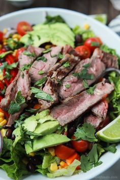 An easy healthy Southwestern Steak Salad loaded with vegetables, tender Ribeye Steak and then topped with a homemade Cilantro Avocado Dressing! Done in 15 minutes, low on calories and rivals any restaurant salad!   joyfulhealthyeats.com #glutenfree