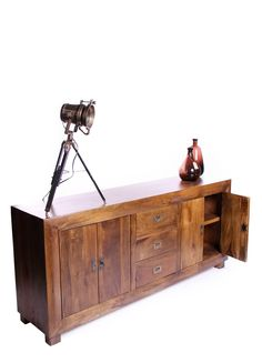 Hand crafted 3 drawer and 4 door sideboard.  Also available in a dark finish.