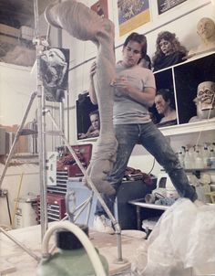 Rick Lazzarini sculpts giant Drone Creature legs for the film INVADERS FROM MARS at Stan Winston Studio.