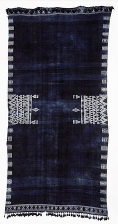 Africa | A shawl, Bakhnuq, from Tunisia | Wool & cotton; the indigo field with two central rectangular panels of white zig-zag and pendant motifs, with geometric borders, tassel fringes to either end