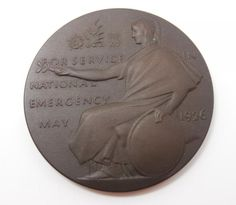 This is an attractive estate found bronze medal designed by Ernest Gillick in England in 1926. The medal was issued to commemorate Service in the National Emergency in May 1926, the General Strike.