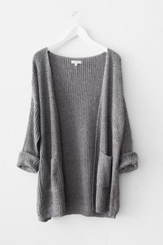 Classic open knit cardigan with long sleeves and large front patched pocket.  Dropped shoulder hem