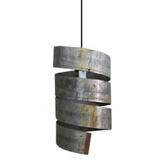In its latest collection, industrial pieces are repurposed and reimagined in a gorgeous light. Crafted from salvaged, industrial-grade steel, this Pendant Light is a real conversation piece. The spiral shape incorporates just enough cracks to allow light to peek through. $378  fab.com