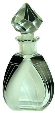 Art Deco Czechoslovakian glass scent bottle decorated with black enamel and frosted with geometric accents.