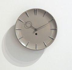 Anonymous; Glazed Ceramic and Enameled Metal Wall Clock by Kienzle, 1950s.