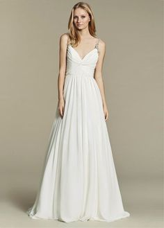 """""""Moonie"""" gown. Ivory chiffon A-line bridal gown, draped bodice with curved V-neckline, beaded straps continued to low scoop back, full gathered chiffon skirt."""