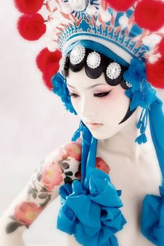 I am so entranced by this image.  I love the red and turquoise, the pale white porcelain skin...