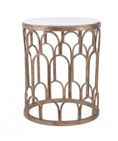 Dunand Side Table - Champagne Like oversized chain mail or a sketch of a tiled roof, the open spaces in the walls of the Dunand Side Table are the element that makes its shape so appealing. Curves of metal in a champagne metallic finish create an of-the-moment sophistication that attractively balances the traditional white marble of the top, giving a paradoxical lightness to the final look.