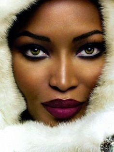 Makeup for Dark Skin :: Naomi Campbell. Plum lipstick. Purple lipstick on dark brown skin.