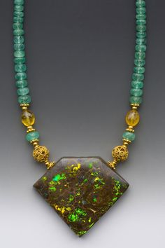 """Elle Schroeder's """"Yellow Calla, Green Leaves"""" - Australian boulder opal on faceted emerald rondelles with 18K gold accents"""