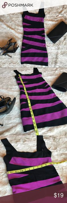 Bebe Body Con Bandage Dress in Black & Magenta The neckline is slightly asymmetrical and it is SUPER stretchy and comfy. Back is solid black. Pair it with some strappy heels or booties for a sassy night out! bebe Dresses Mini