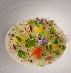 Green tomato gel with coriander seeds, Peruvian corn and aromatic herbs. Alex Atala
