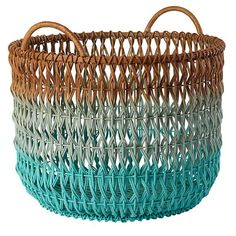 I'd get two of these to be used as hampers by each child's dresser. Ombre Rattan Floor Basket | The Land of Nod