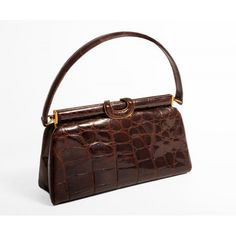 This brown crocodile skin is of top quality and is in pristine condition. Description from bagsofstyle.biz. I searched for this on bing.com/images