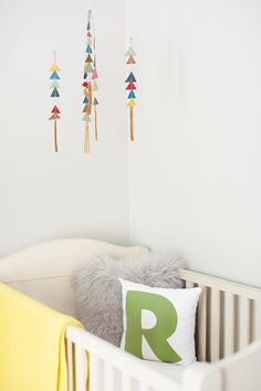 love the triangle mobile over the bed!