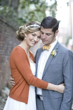 I love cardigans, and I think wearing one over your wedding dress (briefly) is adorable! Especially with the groom's bow tie. How cute.