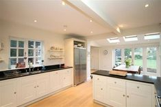 4 bedroom detached house for sale in Mayfield Road, Timperley, Cheshire - Rightmove. House Layout Plans, House Layouts, Stair Storage, Cupboard Storage, Modern Bungalow Exterior, Dining Suites, Paved Patio, Shower Cubicles, Glass Panel Door