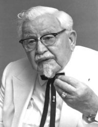 "Harland David ""Colonel"" Sanders (September 9, 1890 – December 16, 1980) was an American fast food businessman who founded the Kentucky Fried Chicken restaurant chain, now re-branded as KFC. His image remains iconic in KFC promotions, and a foundation he established in his later years aids charities and funds scholarships with more than a million dollars in grants a year."