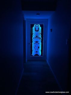 Deep carved sandblasted glass door panel with colour changing LED ribbon edge lighting, designed and handcrafted by Crawford Studios