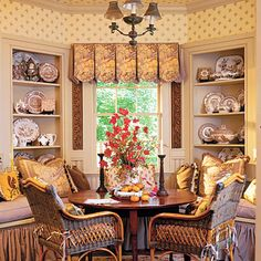 This is such a lovely breakfast nook. The built-in bookcases, the scalloped pleated valance, & the color scheme contribute to a comfortable Country French look.