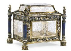 A rock crystal and lapis lazuli casket with enamelled silver-gilt mounts, Hermann Böhm, Vienna, late 19th century rectangular, each side and the graduated lid inset with rock crystal panels engraved with inhabited scrolls, the borders applied with similarly enamelled openwork ornaments