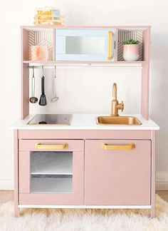 $23 Makeover! The most UNIQUE Ikea Kids Kitchen Hack for only $23!!! This kitchen turned cafe is multifunctional and leads to more creativity for kids. See how easy this transformation is!  #ikeahack #ikeaduktig #ikeahacks #ikeakids #pretendplay #kidskitchen #kidscafe #montesorriikea #ikeamontesorri  #kidsplayrooms #playrooms #pinkikeahack #pinkplayroom #girlsplayroom Ikea Kids Kitchen, Ikea Kids Room, Diy Play Kitchen, Diy Kitchen Storage, Kitchen Hacks, Tv Storage, Record Storage, Ikea Playroom, Play Kitchens