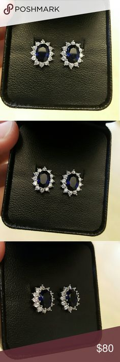 18k Sapphire Swarovski Earrings Brand new never used, comes with a nice box not from Swarovski,  18k plated studs Swarovski crystal Elements with a Sapphire simulated crystal. Not from Swarovski.  Dimensions: 13.3 (H) by 11.1mm (W) .. Chupchick  Jewelry Earrings
