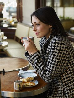 I love this one. Love the real mug and the food and her polished sophisticated look