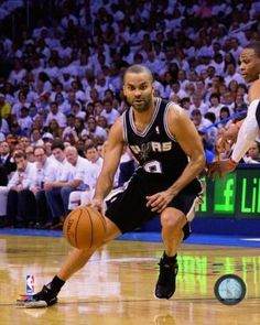 d491a87053a Tony Parker of the San Antonio Spurs drives in Game 6 of the Western  Conference Finals during the 2014 NBA Playoffs at the Chesapeake Energy  Arena on May 31 ...
