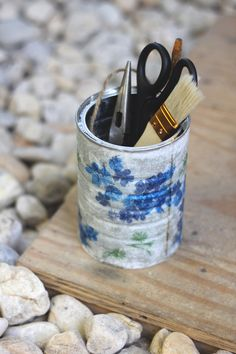 DIY Decoupage Pail - ok a tin can that's perfect for garden tools, or even a small plant.