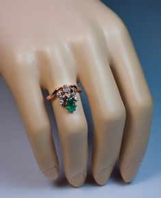 unusual engagement ring - emerald and diamond
