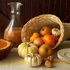 Pretty and simple with a pumpkin, pear, apple, and gourd-filled cornucopia. Plus, find more ideas for fabulous fall centerpieces.