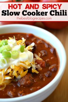 This Hot and Spicy Slow Cooker Beef Chili recipe is perfect on any cold day and will warm you right up! Top it off with sour cream, cheese & green onions.