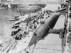 "One of the greatest inland waterways disasters in the history of the United States took place in the Chicago River, Chicago, Ill., July 24, 1915, when the steamship Eastland capsized with a loss of near 850 lives. The photo shows the ill-fated ship after it had turned ""turtle."" (© Bettmann/CORBIS)"