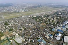 Aerial view of Yokota Air Base, situated near the city of Fussa in western Tokyo, is seen in 2009.