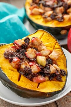 Acorn Squash Stuffed with Apple and Raisins | http://thecookiewriter.com | @thecookiewriter | #sidedish | Baking a whole acorn squash with this apple mixture is the perfect dish for fall! Plus, you can use craisins instead of raisins (and it is vegan, gluten-free, and healthy!)