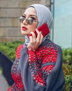 Woman with elegant hijab look, glasses & red cell phone ❤ – Hot Models Islamic Fashion, Muslim Fashion, Modest Fashion, Dubai Fashion, Abaya Fashion, Muslim Girls, Muslim Women, Hijab Outfit, Hijabs