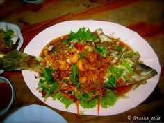 The best fish I've ever eaten. We were in a small open market in Hua-Hin, Thailand where they prepared freshly caught fish. A mix of spicy flavors with lime, cashew and other Thai seasonings.