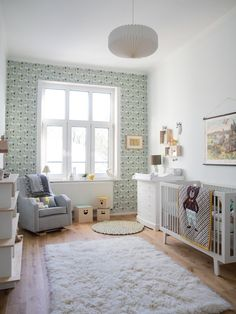 Aidan's Dreamy Room in Germany. Love how uncluttered it is. Wallpaper accent wall on the window wall??